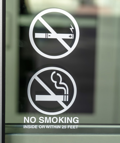Glass window of a building with No Smoking sign